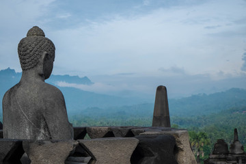 Buddha statue looking over valley