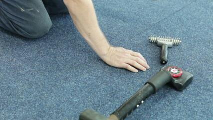 Laying sheets of carpet