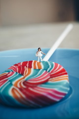 little girl walking on the colorful lollipop