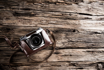 Vintage camera on a wooden background