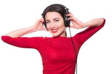Wonderful teenager girl  listening to the music in big headphone