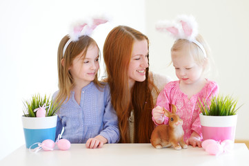 Mother and daughters wearing bunny ears on Easter