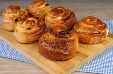 Freshly baked buns with raisins