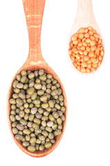 Two wooden spoons with lentils