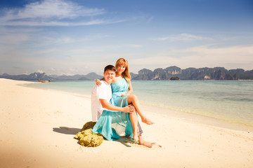young happy asian couple on island