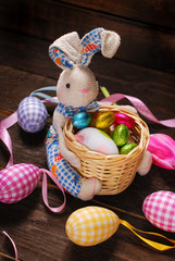 easter decoration with bunny holding basket and eggs