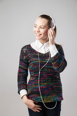 Smiling woman with headphones listening to music