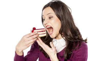 pretty voracious girl eating cake