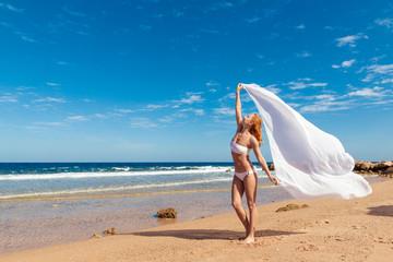 Carefree girl on the beach