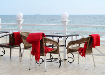 Empty tables at outdoor hotel restaraunt on the beach,Odessa