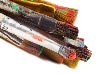 Closeup of different paintbrushes,artist tools,white background