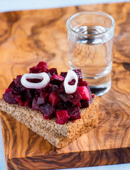 Rye bread with beetroot salad and shot of vodka