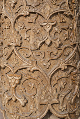 Carved pattern on wood.