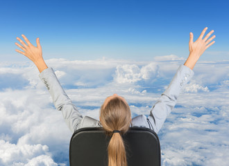 Businesswoman sitting on office chair with her hands