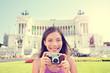 Italy travel - tourist girl taking photos in Rome