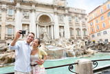 Selfie couple at Trevi fountain, Rome Italy travel