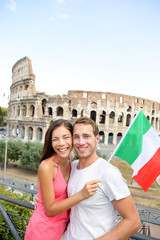 Happy tourists in front of Coliseum, Rome, Italy