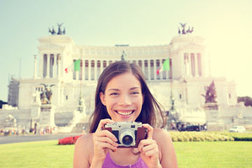 Italy travel - tourist girl taking photos in Rome