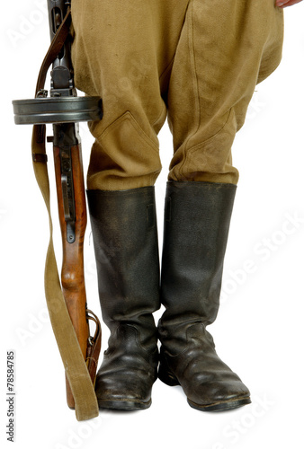 Poster Soviet submachine gun at the foot of a soldier