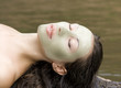 Woman with clay facial mask in beauty spa (Outdoor)