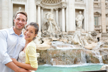 Rome travel - couple in love at Trevi Fountain