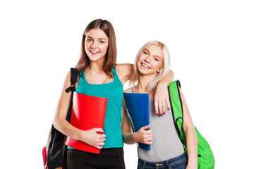 Two happy young students over white background