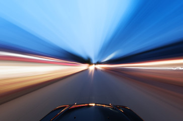 A car driving on a motorway at high speeds,