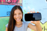 Fototapety Smartphone - young ethnic woman showing screen