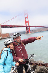 Golden gate bridge - happy biking couple portrait