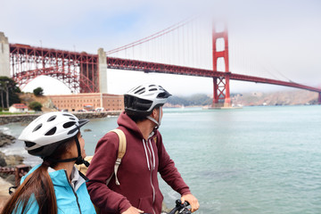 Golden gate Bridge biking tourists on guided tour
