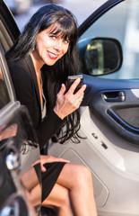 Pretty Woman Sitting in Car