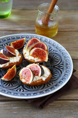 Bruschetta with ripe figs on a plate
