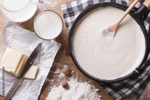 Fotobehang Kruiderij Preparation of bechamel sauce horizontal top view close-up