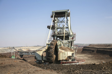 A giant excavator in a coal mine