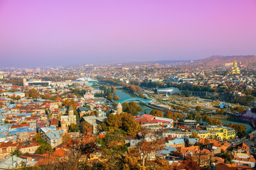 Beautiful panoramic view of Tbilisi at foggy sunset, Georgia