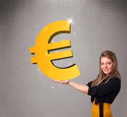 Beautiful girl holding a big 3d gold euro sign