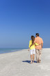 Couple Walking on An Empty Beach