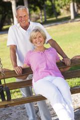 Happy Senior Couple Smiling On Park Bench