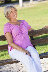 Portrait Happy Senior Woman Sitting Outside