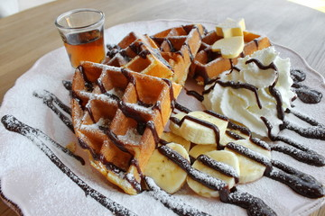 Waffle with banana_whipped cream and syrup