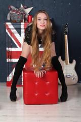 Pretty girl in English style music studio
