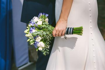 wedding bouquet in hands of bride. wedding couple in love
