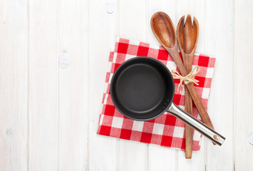 Kitchen utensil over white wooden table background