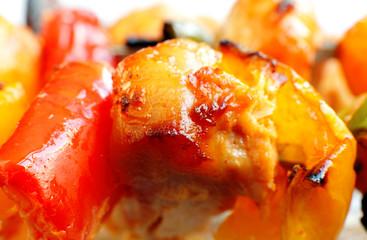 Macro of Chicken tikka and capsicum