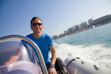man rushes inflatable boats