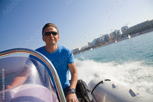 Fotobehang Water Motorsp. man rushes inflatable boats
