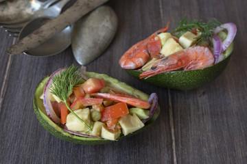 I vegetable salad with prawns, served on avocado shell halves