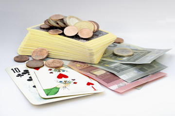 Playing cards and euro currency