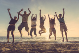 Multiracial group of people jumping at beach poster