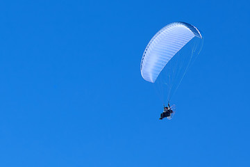 powered paragliding in the blue sky